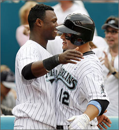 The Marlins' Hanley Ramirez, left, congratulates teammate Cody Ross after Ross hit a go-ahead solo home run in the sixth inning.