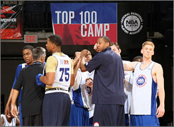 Donyell Marshall, center, was one of 13 players who participated in the NBA Players Coaching Program.