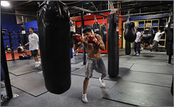 Oscar de la Hoya says Victor Ortiz, working out on the heavy bag Wednesday in Ventura, Calif., has the charisma, work ethic and fighting skills to be boxing's next star.