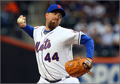 Mets starter Tim Redding, making his seventh start with the Mets, pitched into the eighth inning and earned his first win with New York.