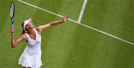 Maria Sharapova serves to Viktoriya Kutuzova during first-round action at Wimbledon on Monday. Sharapova won in straight sets to advance.