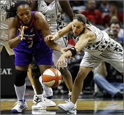 The Silver Stars' Becky Hammon, right, tangles with the Mercury's Le'Coe Willingham for a loose ball. Hammon returned from playing with the Russian national team and scored 19 points for San Antonio.