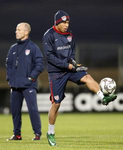 U.S. national team member Charlie Davies controls a ball as coach Bob Bradley stands nearby at the start of a United States national soccer team training session on Tuesday in preparation for a Confederations Cup semifinal match in Bloemfontein, South Africa, on Wednesday.