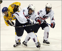 American Jeremy Morin throws a check in game against Sweden in late 2008. Morin, a skilled scorer, is expected to be one of the top American players chosen in the NHL draft.