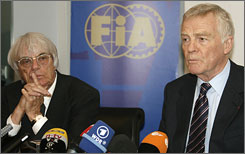 FIA president Max Mosley, right, and Bernie Ecclestone, F1's commercial rights holder, address the media during a meeting in Paris.