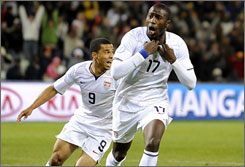 Team USA's Jozy Altidore, right, celebrates his goal against Spain as teammate Charlie Davies gives chase during the Americans' 2-0 victory over the Spaniards in the semifinals of the Confederations Cup.