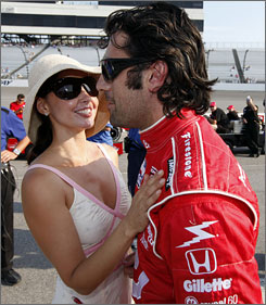 Dario Franchitti gets a hug from his wife, actress Ashley Judd, after winning the pole for the SunTrust Indy Challenge at Richmond International Raceway.