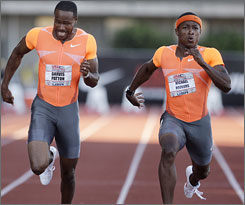 Mike Rodgers, right, edges out Darvis Patton to win the 100-meter final at the U.S. championships.