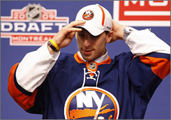 Canadian forward John Tavares dons the garb of the New York Islanders after being chosen No. 1 in the NHL Draft on Friday night.