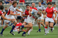 The United States' Shawn Pittman runs the ball last week in Denver in a Churchill Cup match against Georgia. The Churchill Cup is the only international rugby event held in the United States.