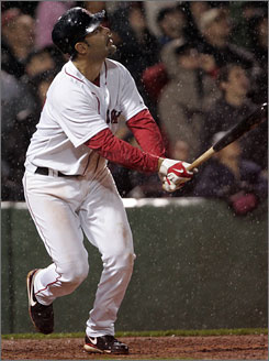 Boston's Mike Lowell, who underwent hip surgery in the offseason, was placed on the 15-day disabled list on Tuesday.