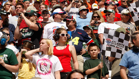 Fans watch the action March 8 during the NASCAR Sprint Cup Series' Kobalt Tools 500 at Atlanta Motor Speedway. NASCAR's fan base has become wealthier and more educated since 2000, research shows.
