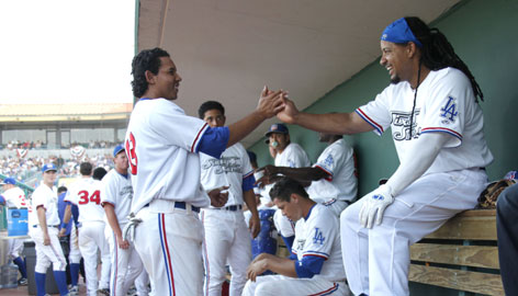 "Manny Ramirez, right, with his Inland Empire teammates on Sunday, is returning from a 50-game suspension for violating MLB's drug policy. ""His addition is a big plus on the field and in the (locker) room,"" Dodgers GM Ned Colletti says."