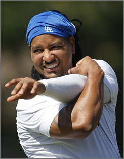 Manny Ramirez, stretching before a game, is more rock star than baseball player in Los Angeles these days.