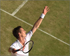 Andy Murray serves during his straight-set victory over Juan Carlos Ferrero in the quarterfinals at Wimbledon. With the win, Murray inched closer to becoming the first Brit since Fred Perry in 1936 to win the singles championship at the All England Club.