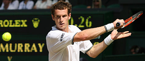 Andy Murray plays a backhand during his quarterfinal victory over Juan Carlos Ferrero on Centre Court.