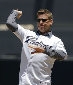 Hall of Fame quarterback Troy Aikman throws out the ceremonial first pitch before the Astros and Padres game. Aikman is a part-owner of the Padres.