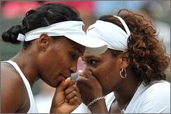 Venus and Serena Williams, shown playing doubles together this week, will face off in the Wimbledon final on Saturday.