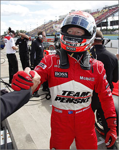 Ryan Briscoe celebrates winning the pole for Sunday's IndyCar Series' Watkins Glen Camping World Grand Prix.