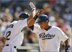 The Padres' Everth Cabrera, right, getting congratulated by teammate Scott Hairston, drove in three runs to help San Diego beat the Dodgers.
