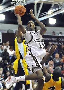 Tristan Thompson of St. Benedict's Preparatory school of Newark, New Jersey, center, drives to the basket during a game in Springfield, Mass. on Sunday, Jan. 19. Thompson, the No. 1-ranked power forward in the class of 2010, has attended three high schools in his career.