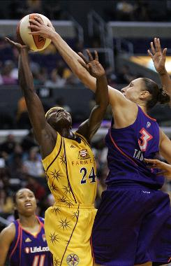 Los Angeles' Marie Ferdinand-Harris has her shot blocked by the Mercury's Diana Taurasi during the second half. Taurasi tallied 20 points, six assists and three blocks as Phoenix rolled 104-89.