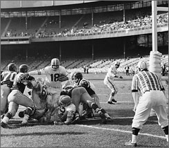 Broncos QB Frank Tripucka scores a touchdown against the Titans of New York in 1962. The team had worn striped socks the two previous seasons.