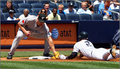 Blue Jays third baseman Scott Rolen tags Yankees baserunner Derek Jeter on a steal attempt in the first inning. Jeter was called out, sparking an argument and the ejection of Yanks skipper Joe Girardi.