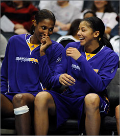 Los Angeles Sparks center Lisa Leslie, left, laughs with forward Candace Parker during a basketball game against the Atlanta Dream in 2008. Leslie has been with the WNBA since its inception in 1997 and is the league's all-time scoring leader.