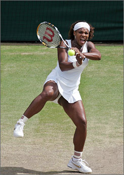 Serena Williams grunts while returning a shot to her sister Venus in the Wimbledon women's singles final Saturday. Serena beat Venus in straight sets.
