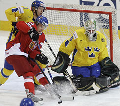Swedish goaltender Jonas Gustavsson, playing in the Ice Hockey World Championships on May 7, signed with the Maple Leafs over the Sharks, Avalanche and Stars.