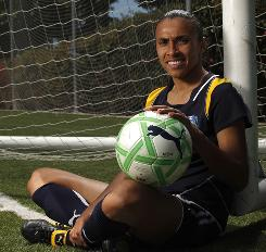 Marta's magical touch on the ball keeps fans coming to WPS games and has her Los Angeles Sol in first place.
