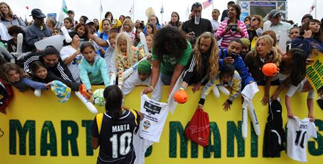 "Marta signs autographs for ""Marta Maniacs"" after a Los Angeles Sol game in March."
