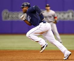 Tampa Bay's        Carl Crawford takes off to steal second base against Boston on May 3. Crawford leads the major leagues with 41 steals but doubts he'll reach 100 because of the toll it takes on his body.
