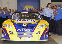 Martin Truex Jr. climbs out of the NAPA Auto Parts Toyota as he was presented as a new    Michael Waltrip Racing team driver on Tuesday in North Carolina.
