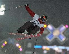 Sarah Burke goes airborne while winning the gold at Winter X Games 13 on Jan. 23. Burke, who usually spends her summers training in the mountains, will participate in the Iraq tour.