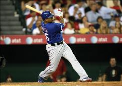 The Texas Rangers' Andruw Jones smacks his third home run of the game against the Los Angeles Angels of Anaheim in the fifth inning at Angel Stadium in Anaheim, Calif. Aided by Jones' four RBI, the Rangers won 8-1.