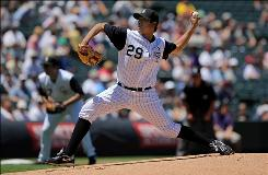 Colorado Rockies starter Jorge De La Rosa delivers against the Washington Nationals at Coors Field in Denver. De La Rosa pitched effectively into the seventh inning, giving up three runs as the Rockies swept the Nationals with a 10-4 win.