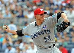 Toronto Blue Jays pitcher Roy Halladay, shown here against the New York Yankees on July 4, has been the subject of trade rumors as the deadline draws near, but few clubs have the money and prospects to acquire him.