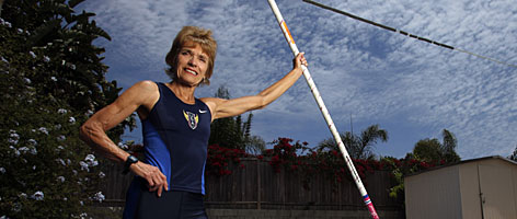Nadine O'Connor, 67, shows off the pole-vaulting pit at her and Bud Held's San Diego-area property, which includes a 100-foot runway.