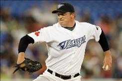 Pitcher pitcher      B.J. Ryan, shown here against the Tampa Bay Rays on June 29, was released by the Toronto Blue Jays on Wednesday.