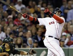 Boston's David Ortiz follows through on a three-run homer, the 300th of his career, as Oakland catcher Kurt Suzuki watches in the sixth inning at Fenway Park. The Red Sox would lose to the Royals 8-6.