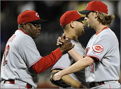 Reds Manager Dusty Baker, left, congratulates Bronson Arroyo after the pitcher blanked the Mets for his second career shutout.