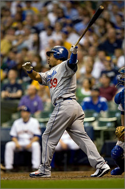 Manny Ramirez, watching his two-run home run leave Miller Park in the sixth inning, tied Mickey Mantle on the career home run list with 536.