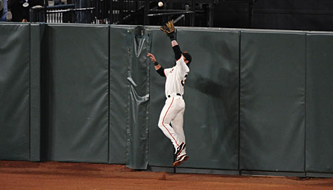 Giants center fielder Aaron Rowand leaps to rob the Padres' Edgar