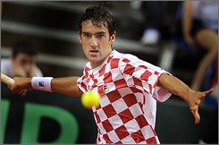 Marin Cilic posted two singles wins to help Croatia beat the United States in their Davis Cup quarterfinal.