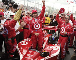 Dario Franchitti and his teammate celebrate their victory in Toronto.