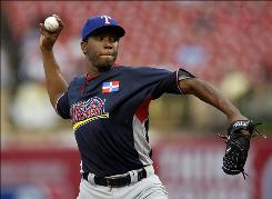 World pitcher Neftali Feliz delivers a pitch during the 2009 Futures Game at Busch Stadium. The World team came from four runs down to win 7-5.