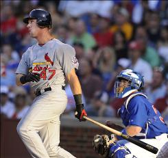 The St. Louis Cardinals' Ryan Ludwick watches his two-run home run against the Chicago Cubs leave the park at Wrigley Field in Chicago. Ludwick added another two-run bomb as the Cardinals took the nightcap of the doubleheader 4-2.