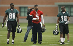 Donovan McNabb, center, has two years remaining on a reworked contract with the Eagles. He won't commit to anything more than trying to win a Super Bowl in the next two years.